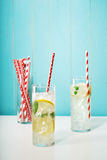 Lemonades with assorted big red paper straws Stock Images