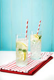 Lemonades with big red striped straws Royalty Free Stock Photography