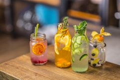 Lemonades. Lemonades with fresh tropical fruit and cucumber on b Royalty Free Stock Photography