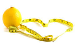 Lemone and measure tape. Dieting concept Stock Photography