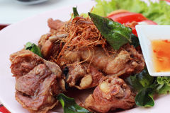 Lemongrass chicken in a dish with sauce. Stock Photography