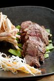 Lemongrass grilled beef steak with snow peas Royalty Free Stock Images