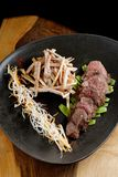Lemongrass grilled beef steak with snow peas Royalty Free Stock Image