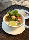 Lemongrass seafood soup with steamed rice Stock Photo