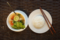 Lemongrass seafood soup with steamed rice Stock Photos