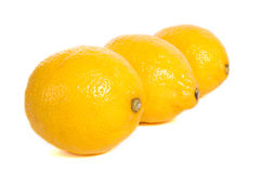 Lemons. Three ripe lemons isolated on white background Stock Photography