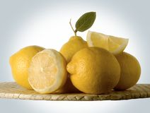 Lemons. Yellow lemons with green leaf stock images