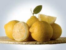 Lemons. Yellow lemons with green leaf Stock Images