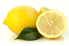 Lemons. A high resolution image of lemons cut and whole with a leaf royalty free stock images