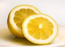 Lemons. Lemon sliced on white plate Stock Photo