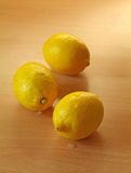 Lemons. On wooden surface counter Royalty Free Stock Photos