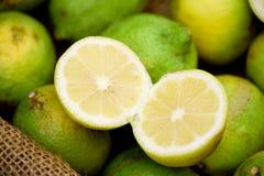 Lemons. Sliced lemon in basket being sold stock photo