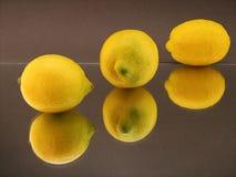 Lemons. 3(6) lemons on colored background Royalty Free Stock Photos