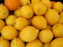 Lemons. Horizontal background of freshly picked healthy yellow lemon fruits on a market outdoors Stock Photos