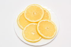Lemons. There are many lemons on plate Stock Photo