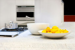 Lemons. Yellow lemons in bowl at kitchen counter Royalty Free Stock Photography