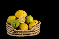 Lemons in a basket. On  black background Stock Image