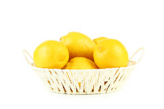 Lemons in basket Royalty Free Stock Photo
