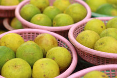 Lemons in a basket at the market. Stock Photo