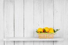 Lemons in a basket Stock Images