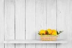 Lemons in a basket Stock Images