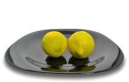Lemons on a black plate Royalty Free Stock Photography