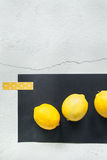 Lemons on a Black Surface Royalty Free Stock Photo