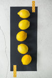 Lemons on a Black Surface Royalty Free Stock Photos