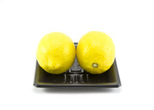 Lemons on black tray isolated.  royalty free stock photo