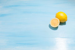Lemons on a blue background Royalty Free Stock Photos