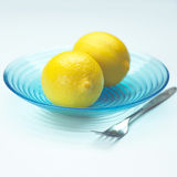 Lemons in blue bowl Stock Photography