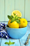 Lemons in a blue bowl. Royalty Free Stock Photography