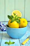 Lemons in a blue bowl. Royalty Free Stock Images
