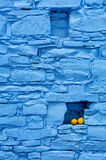 Lemons on blue wall in cyprus. Lemons in an alcove on an old rock wall on the island of cyprus that is painted blue Royalty Free Stock Photos