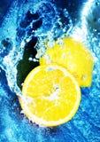 Lemons in blue water stock photos