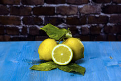 Lemons on a blue wood Royalty Free Stock Images