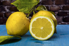 Lemons on a blue wood Stock Photos