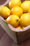 Lemons in box - close-up Stock Image