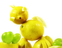 Lemons chicken. Abstract construction from fruits: lemons chicken Royalty Free Stock Images