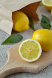 Lemons on chopping board. Lemons on a chopping board Stock Photography