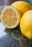 Lemons on the chopping glass. Stock Image