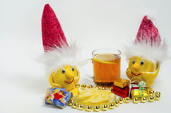 Lemons in Christmas hats and tea with lemon Royalty Free Stock Photo