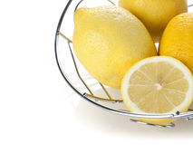 Lemons in chrome basket Stock Photo
