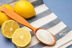 Lemons and citric acid in a wooden spoon. Close-up stock photos