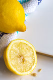 Lemons and cloth on white board background with copy space Royalty Free Stock Photos
