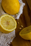 Lemons and cloth on wooden background with copy space. Vertical Royalty Free Stock Image