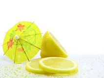 Lemons with cocktail umbrella Stock Images
