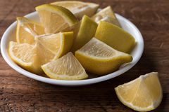 Lemons. Cut into chunks in a bowl Royalty Free Stock Photos
