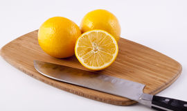 Lemons on a Cutting Board Stock Images