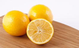 Lemons on a Cutting Board Royalty Free Stock Image